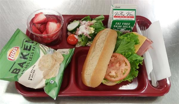 Cold Cut Combo Sub, Lettuce/Tomato, Baked Chips, Fruit Choice (shown with salad bar)